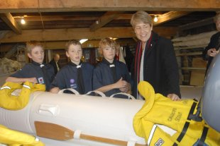 ARC Finance Chairman  Wyn Hoadley gets some advice from the Sea Scouts on Safety.